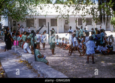 Uniformed students in a schoolyard on Nauru, Central Pacific - Stock Photo