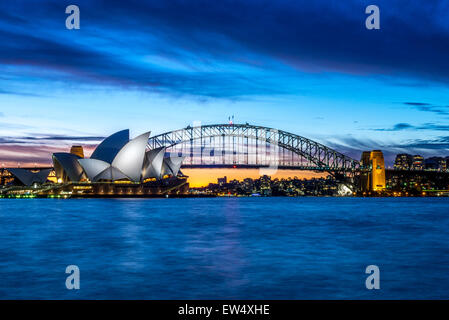 Sydney Opera House and Bridge at sunset - Stock Photo