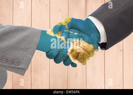 Composite image of handshake between two business people - Stock Photo