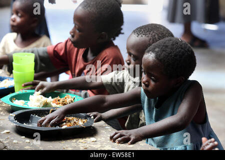 Feeding for orphans in a center run by the catholic church, Township Chifubu in Ndola, Zambia, Africa - Stock Photo