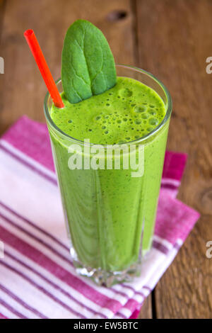 Green spinach smoothie in glass - Stock Photo