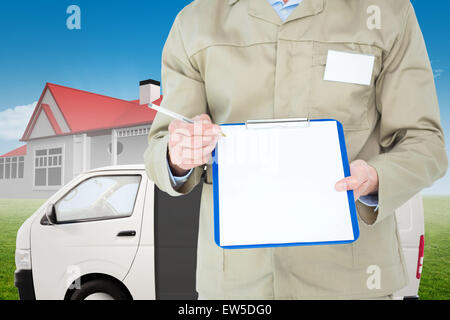 Composite image of delivery man showing blank paper on clipboard - Stock Photo