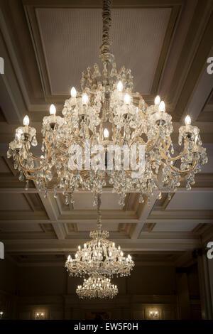 ornate crystal glass chandelier - Stock Photo