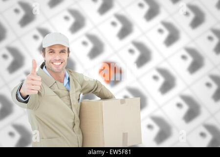 Composite image of happy delivery man gesturing thumbs up while carrying box - Stock Photo