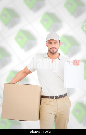Composite image of delivery man with cardboard box showing clipboard - Stock Photo
