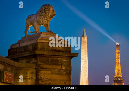 Lion statue overlooking the Egyptian Obelisk at Place de la Concorde and Eiffel Tower, Paris, France - Stock Photo