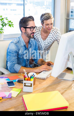 Casual businesswoman showing the screen to her partner - Stock Photo