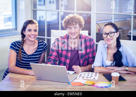 Happy designers smiling at camera - Stock Photo