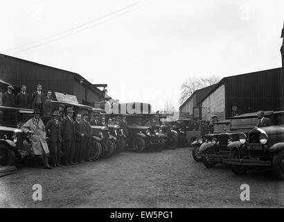The staff of Uxbridge builders merchants Kirby Brothers pose beside their lorries and vans, London. Circa 1930 - Stock Photo