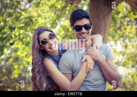 Cute couple in the park - Stock Photo