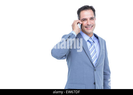 Portrait of a successful businessman on phone against white - Stock Photo