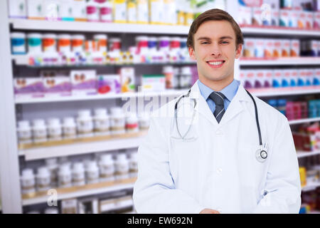 Composite image of young doctor using tablet pc - Stock Photo