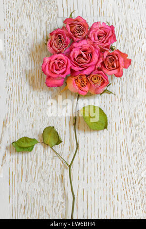 Bouquet of dried roses on table wood - Stock Photo