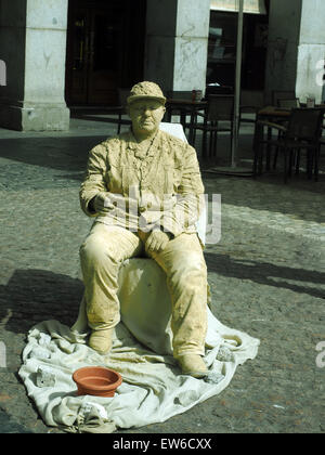 MADRID-MAY12: An unidentified street live statue entertainer performs for tourist as a live statue in cement make - Stock Photo