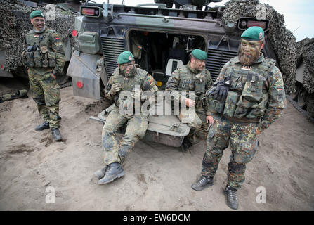 Sagan, Poland. 18th June, 2015. German soldiers rest next to their Marder tank during the first 'Noble Jump' maneuvers - Stock Photo