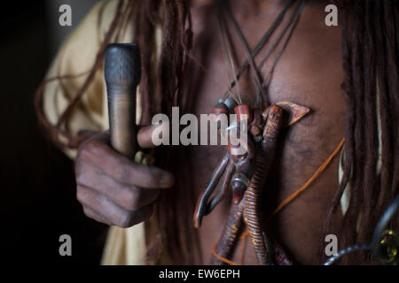 The ornamentation and pipe of a Hindu Sadhu is held in Kathmandu's Pashupatinath Temple in Nepal. - Stock Photo