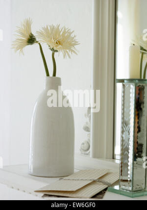 Two White Chrysanthemums In A Tall White Ceramic Vase Stock Photo