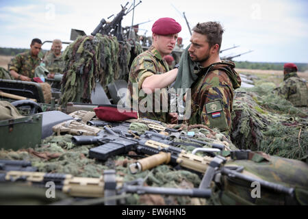 Sagan, Poland. 18th June, 2015. Soldiers remove camouflage paint from their faces after the first 'Noble Jump' maneuvers - Stock Photo