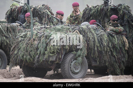 Sagan, Poland. 18th June, 2015. NATO soldiers operate in camouflaged vehicles during the first 'Noble Jump' maneuvers - Stock Photo