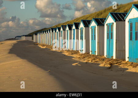 White and blue beach houses on the island of Texel in the Netherlands. - Stock Photo