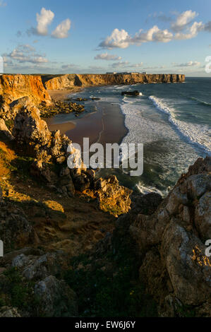 The cliffs of Sagres and the waves of the Atlantic in the Algarve region of Portugal. - Stock Photo