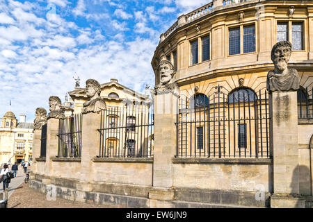 OXFORD CITY THE EMPEROR HEADS OR HERMS OUTSIDE THE SHELDONIAN THEATRE - Stock Photo