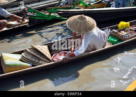 Woman on her boat selling goods at one of the 5 day rotating markets at  Nampan Market on Inle Lake,Shan State Myanmar - Stock Photo
