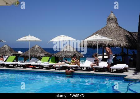 Vacationers sitting around pool at Villa Premiere Hotel and Spa, Puerto Vallarta, Mexico - Stock Photo