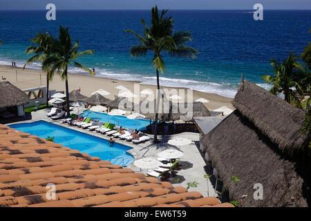 View of pool and beach, Villa Premiere Hotel and Spa, Puerto Vallarta, Mexico - Stock Photo