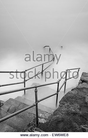A long exposure of the steps at Porthkerry caravan park at high tide. - Stock Photo