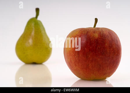 Red apple and green pear food fruit fruits studio - Stock Photo