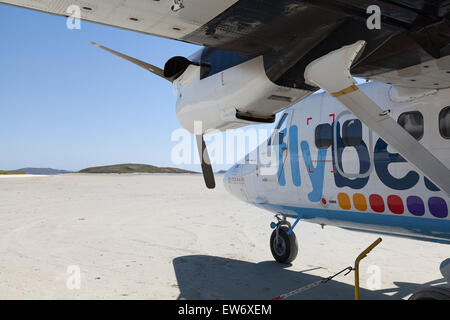 Flybe airplane on the sandy runway of Barra International airport, in the Outer Hebrides of Scotland - Stock Photo
