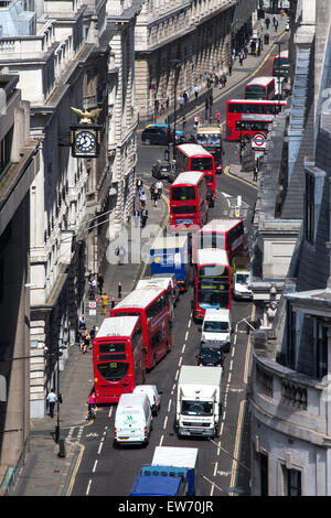 Birds-eye view of red double decker buses on a busy London street - Stock Photo