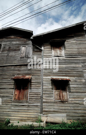 2 large old wooden houses adjacent - Stock Photo