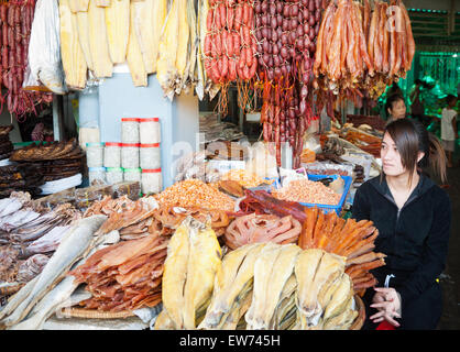 A dried fish and meat vendor at the Central Market (aka Psah Thom Thmey or New Grand Market) in Phnom Penh, Cambodia. - Stock Photo