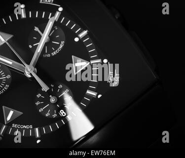 Luxury mens Chronograph Watch made of black high-tech ceramics with sapphire glass. Close-up studio photo with selective - Stock Photo