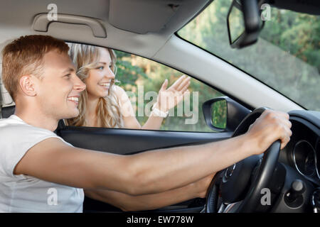 Young couple in the car - Stock Photo