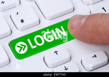 Push Login button submit with password on computer - Stock Photo