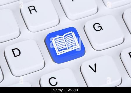 Reading book on internet computer keyboard icon symbol - Stock Photo