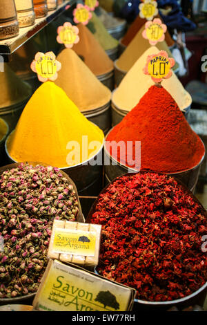 Colourful spices for sale at this street stall within the maze of narrow alleys that exist in this souk area just - Stock Photo