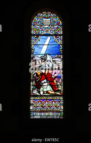 Stained glass of The Conversion of Saul in the Saint-Pierre-Saint-Paul de Pléneuf Church. - Stock Photo