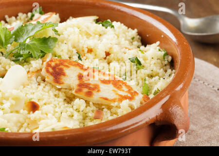 Lemon and parsley couscous with almonds and halloumi - Stock Photo