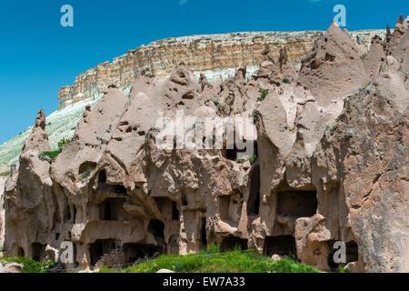 The abandoned rock carved village of Zelve, Zelve open air museum, Cappadocia, Turkey - Stock Photo