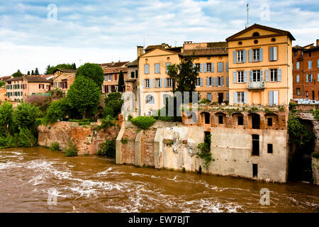 View over the River Tarn to houses perched on the bank in Albi - Stock Photo