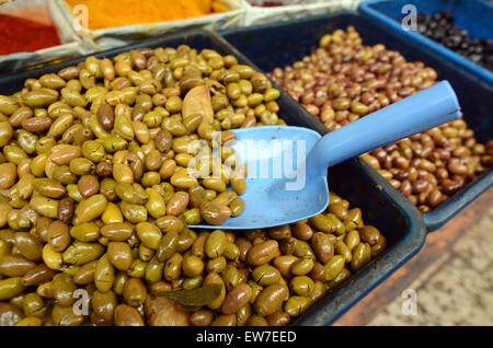 Olives on display in Middle eastern food market in Akko Acre Israel. Food background texture. - Stock Photo