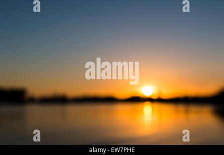 Orange Sunset Over River Daugava Riga Europe Blurred Background Nobody No People Night Evening Dusk - Stock Photo