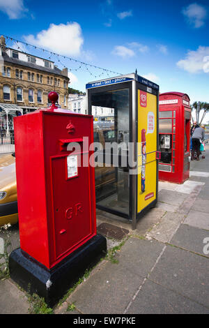 UK, Wales, Conwy, Llandudno, Gloddaeth Street, street furniture including unusual rectangular post box - Stock Photo