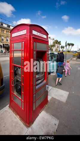 UK, Wales, Conwy, Llandudno, Gloddaeth Street, K6 phone box converted into cash machine - Stock Photo