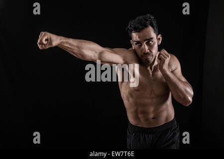 Portrait of a man boxing - Stock Photo