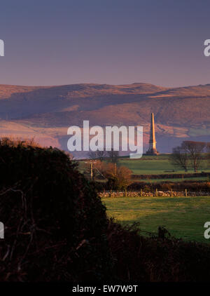Twr Hill, Anglesey: a tall obelisk erected in 1876 by the Williams Bulkeley family on their Baron Hill estate above - Stock Photo
